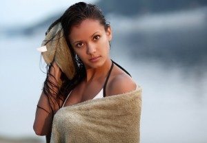 beautiful girl mulatto towel on the beach